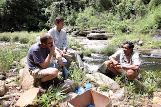 Photo: Discussions at the river - campsite 2.