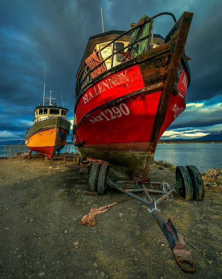 Longing for the sea by Haim Rosenfeld - Transportation Boats ( dreamy, natales, mountain, mystery, travel, drama, contemplate, shot, spot, sky, nature, movement, place, light, foreground, dream, patagonia, windy, colors, white, mood, image, puerto, atmosphere, lake, shape, picture, outdoors, moody, scene, view, exposure, waterscape, colorful, land, sphere, beauty, landscape, chile, mountains, puerto natales, dramatic, nikon, rocks, shyne, clouds, water, beautiful, scenic, boat, photo, great, blue, outdoor, scenery, stunning )