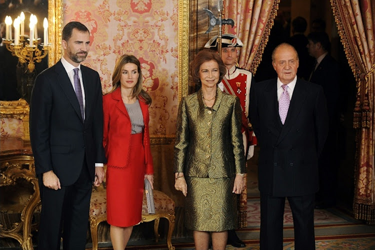 A file photo taken shows members of the Spanish royal family (from L) Prince Felipe de Borbon and his wife Letizia Ortiz, Queen Sofia and King Juan Carlos de Borbon posing in the Royal Palace in Madrid. Picture: AFP