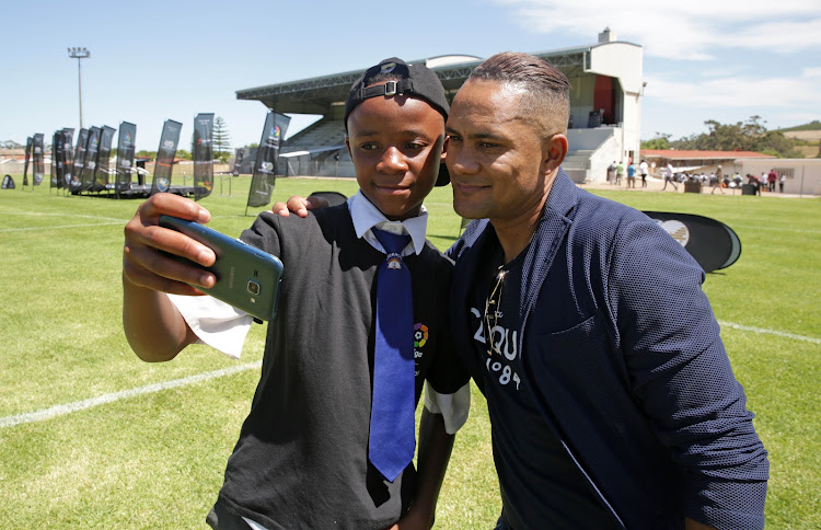 Former Kaizer Chiefs and Bafana Bafana play maker Stanton Fredericks, who is also the LaLiga Ambassador, interacts with the kids during the LaLiga Pass The Ball initiative at Idas Valley Sports Complex in Stellenbosch, Cape Town on March 2 2018.