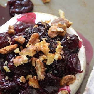Baked Brie with Warm Honeyed Grapes and Walnuts.