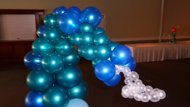 Photo: 7' tall Sea Horse balloon sculpture. Design by the Awesome Chris Horne CBA, a few extra details by us for the Under the Sea themed Grand Haven High School Prom 2011 at Trillium Banquet Hall, Spring Lake, Michigan. Awesome place, love the LED ceiling!