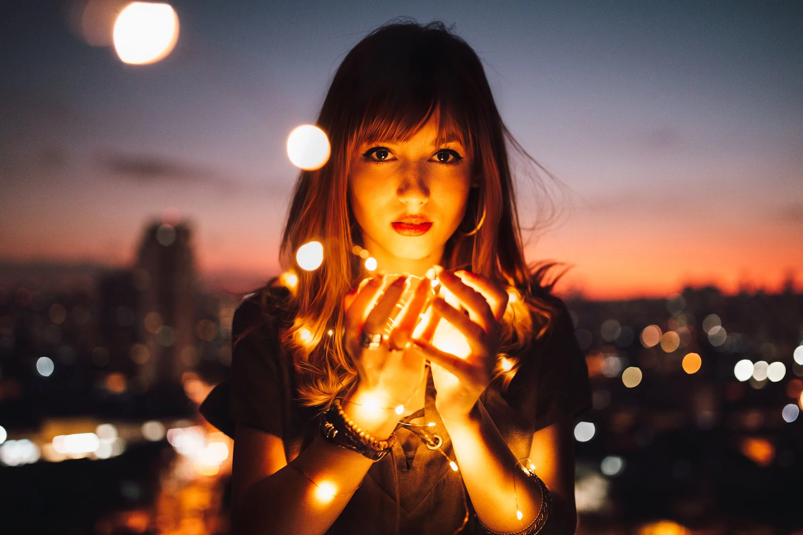 girl holding light at night