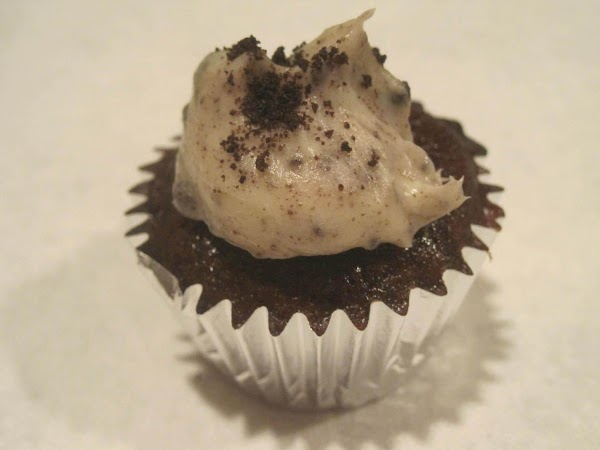 Top each little cooled brownie cupcake with a dollop of frosting. Sprinkle with remaining...