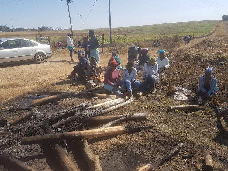 Kranskop community members outside the Aussicht Farm after tensions flared on August 6 2018.