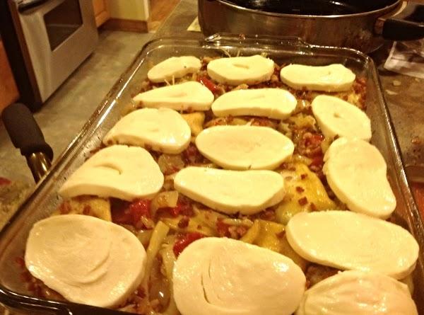 Add the sliced fresh mozzarella, shredded mozzarella the real bacon bits, and add shredded...
