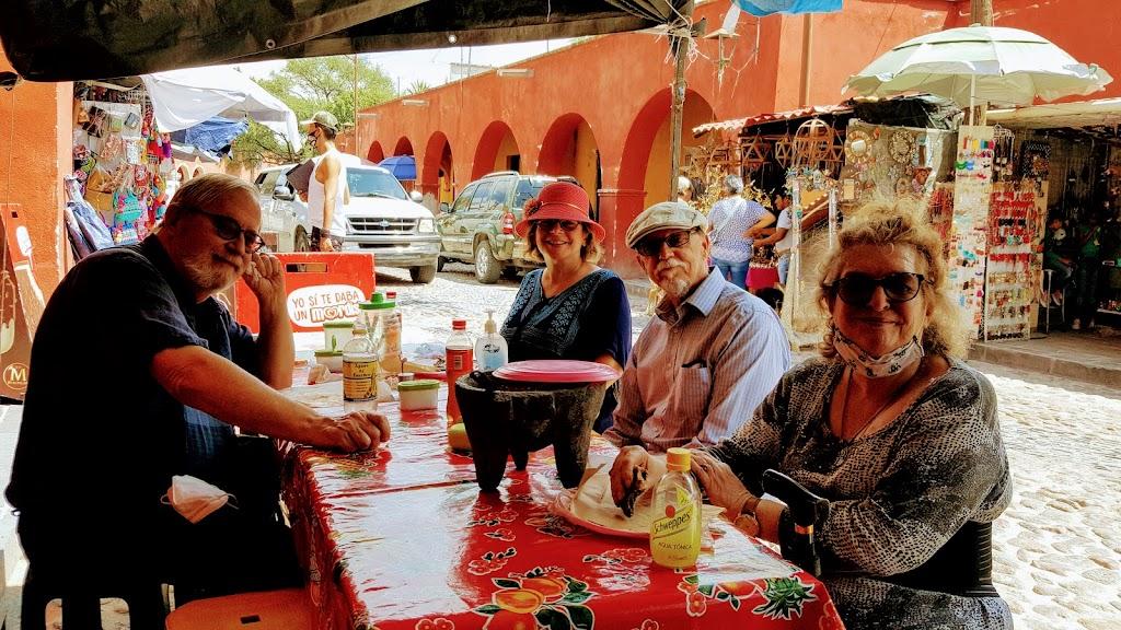 Enjoying lunch on Atotonilco village street.