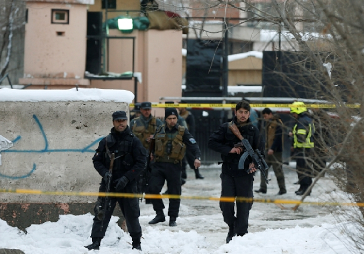 Afghan policemen keep watch at the site of a bomb blast in Kabul, Afghanistan.     Picture: REUTERS
