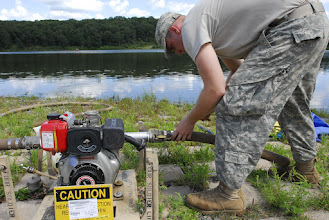 Photo: Wisconsin National Guard Soldiers from the 257 Brigade Support Battalion performed their 2-week annual training at Camp Ripley, Minn. this month. Water Treatment Specialists of Alpha Company spent a few days at Lake Ferrell testing the water, their skills and their equipment. Spc. Daniel Clark connects water lines to the pump.  Photo by Sgt. 1st Class Daniel Ewer http://www.minnesotanationalguard.org/press_room/e-zine/articles/index.php?item=3429