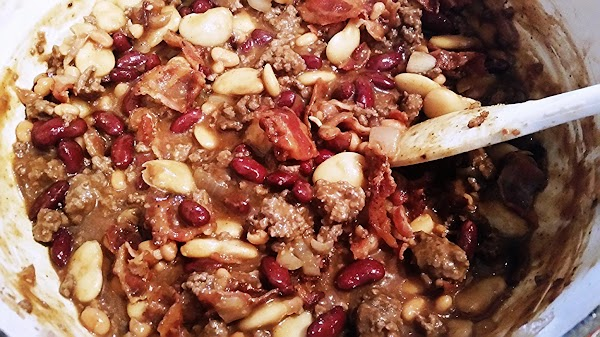In a skillet cook onion and ground chuck in oil, breaking apart meat as...