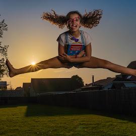 happy student by Michel Vandermeersch - Babies & Children Child Portraits ( jumping, young girl, golden hour, sony alpha, air, evening, daughter )