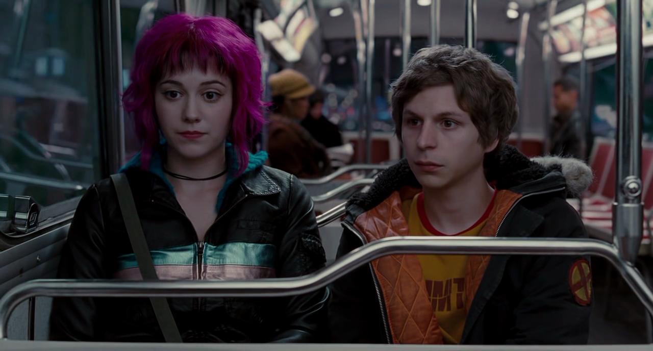 Scott Pilgrim with a lady friend on a train