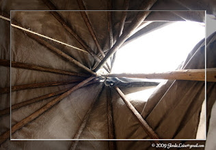 """Photo: Looking up from the center of an actual tee pee.  The 'engineering"""" involved in the design is ingenious.  I was surprised at the size of the poles holding up the tee pee."""