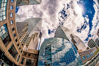 Photo: This shot shows the back of the World Financial Center in New York City. The glass atrium area was destroyed on 9/11 but was rebuilt. Just peeking out from behind one of the buildings on the left is the new One World Trade building, currently under construction.  #breakfastclub curated by +Stuart Williams