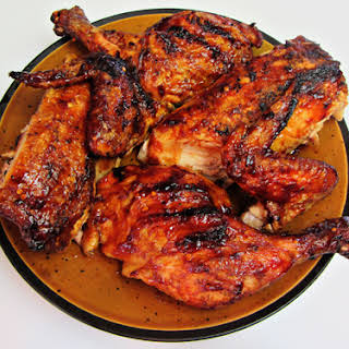 Grilled Butterflied Whole Chicken with Barbecue Sauce.