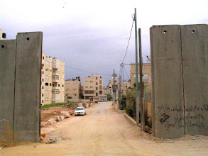 Photo: Israeli Apartheid Wall in the occupied West Bank, encircling Palestinian villages, cutting Palestinians off from their land, separating families and neighbours, cutting off access to work, school, medical care.  Not about 'security'.