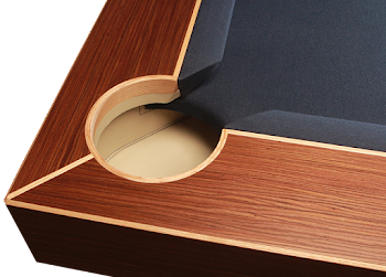 a bird's eye view of the corner pocket of the arc pool table with varnished finishing and blue felt