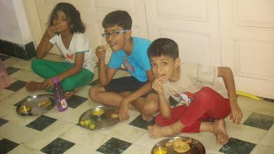 Photo: Eating and Enjoying Aamras Puri!
