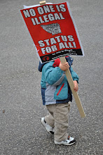 Photo: Poor kid, that sign is almost as tall as he is!