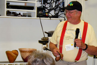Photo: Bob Grudgberg always has fun with his woodturning.  He brought in his signature open segmented bowl sitting on the lathe behind him but...