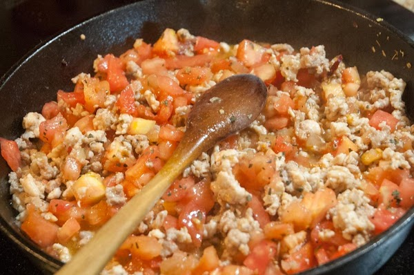 Add the tomatoes, basil, and oregano, and stir to combine.