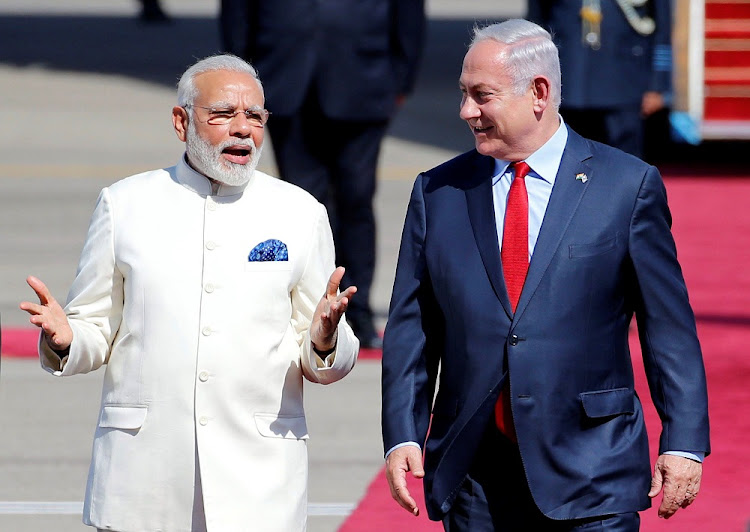 Israeli Prime Minister Benjamin Netanyahu, right, welcomes Indian Prime Minister Narendra Modi during an official welcoming ceremony upon his arrival in Israel at Ben Gurion Airport, near Tel Aviv, Israel on July 4, 2017.    Picture: REUTERS