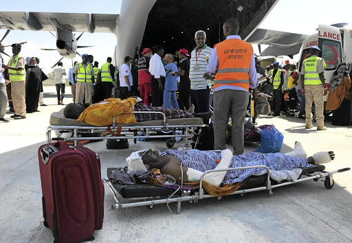 Civilians injured during an explosion in Mogadishu wait to board a Turkish military plane for medical evacuation at the Aden Abdulle International Airport in Mogadishu, Somalia, on October 16 2017. Picture: REUTERS