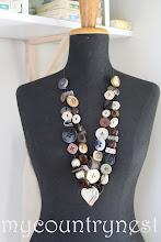 Photo: collana doppia fila bottoni e cuore argentone