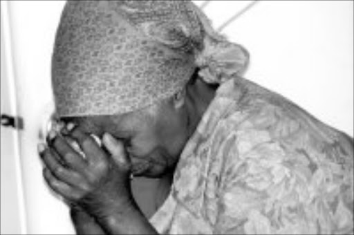 IN MOURNING: Josephine Mvuka weeps over the death of her sister Joyce, who died after eating suspected poisoned food after a baptism at the AME Church. Pic. Mbuzeni Zulu. 12/02/07. © Sowetan.