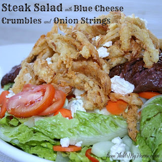 Steak Salad with Blue Cheese Crumbles and Onion Strings