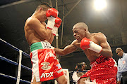 Moruti Mthalane on his way to become IBF  flyweight champion  when he outpointed Julio Miranda from Mexico in 2009.