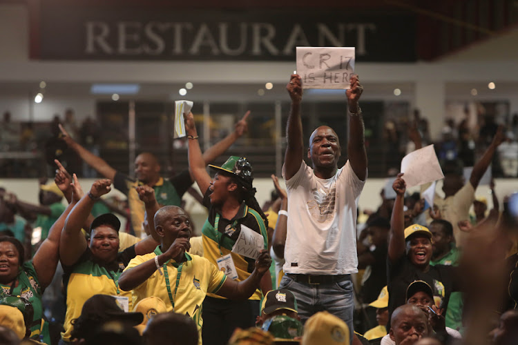 Cyril Ramaphosa's supporters celebrate upon hearing that he has won the vote for ANC president at the party's Elective Conference held at Nasrec Johannesburg on 18 December 2017.