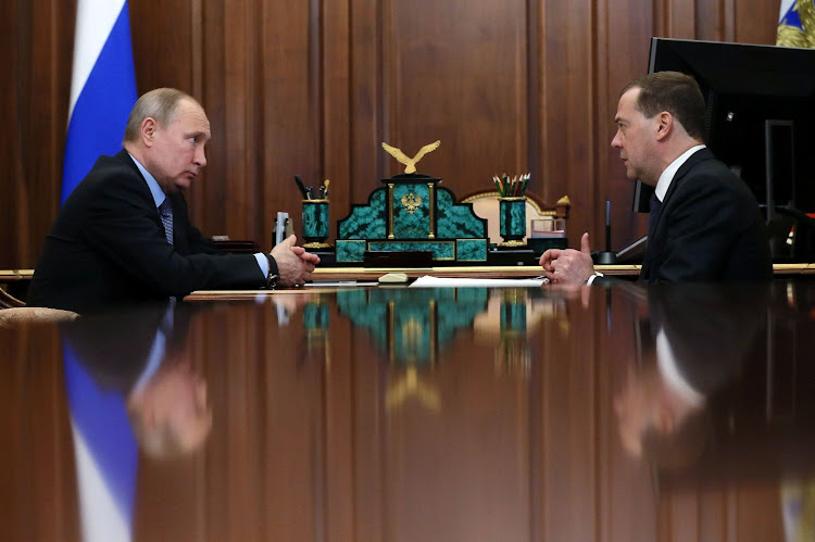 Russian President Vladimir Putin, left, meets Prime Minister Dmitry Medvedev in Moscow, Russia, on January 18 2019. Picture: SPUTNIK/EKATERINA SHTUKINA/POOL VIA REUTERS