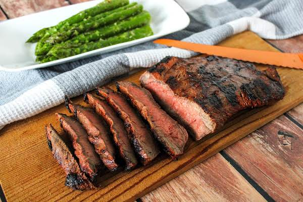 Grilled Flat Iron Steak Sliced And On A Serving Tray.