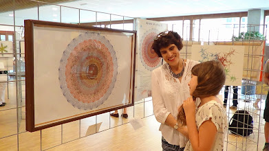 Photo: Moira Chass and her daughter, watching the E8 Polytope stringy art.