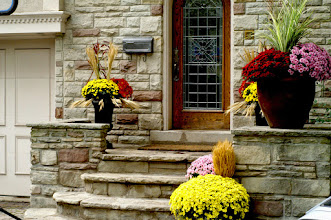 Photo: The mortar on these steps was failing and the stones themselves were spalling away. Fern Ridge rebuilt the steps and installed planters to soften the look.