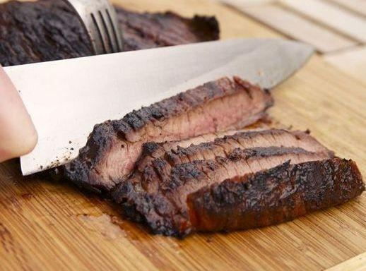 Drain steak, reserving marinade. Grill steak on the grill directly over hot coals for...