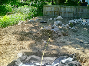 Photo: Acorn Ponds & Waterfalls, we install ponds, water features and low maintenance water gardens. #PondRenovation and maintenance are our specialties. Check out our website www.acornponds.com and give us a call 585.442.6373.  Aquascape Waterfalls Water Feature Construction is in full swing. Basin is now installed with Aqua blocks and now we can build the Stream and Waterfalls for this Penfield NY home.  To see more of our #pondinstallations on Facebook click here: www.facebook.com/media/set/?set=a.464911070212687.94604.103109283059536&type=3  To learn more about Landscape Design, please click here: www.acornponds.com/landscape-design.html  For More info about Geoff and Karen's amazing project please visit www.facebook.com/notes/acorn-landscaping-landscape-designlightingbackyard-water-gardens/landscape-design-installation-walkway-patio-rock-fountain-waterfall-in-penfield-/238744206162709  Acorn Ponds & Waterfalls of Rochester NY, 585-442-6373, is a Certified Aquascape Contractor, Landscape Designer, Outdoor Lighting Designer, Installer, Builder, Contractor and Design Service Company from Rochester, NY. We have professional Installation and Design Services available for the following: Landscape Design Outdoor Room Design Backyard Ponds and Waterfalls Design & Construction Patios and Walkways: Paver, Stone, Brick Low Voltage Landscape Lighting LED Landscape Lighting Swimming Ponds Ecosystem Ponds LED Outdoor Lighting Retaining Walls Fountains Water Features Pondless Waterfalls Pond Maintenance and Design Aquatic and Under Water LED Lights Bubbling Boulders and Urns Natural Stone Patios and Rock Gardens Garden Ponds Outdoor Kitchens Pizza Ovens Fire Pits Fish or Koi Ponds Waterfall Ponds Low Maintenance Plantings Commercial Landscape Design Residencial Landscape Design Drainage Issues, Solutions Aquascape Rainwater Collection Systems  We serve Pittsford NY, Penfield NY, Brighton NY, Fairport NY, Webster NY, Greece NY, Victor NY, Henrietta NY, Irondequoit NY, Rush NY 