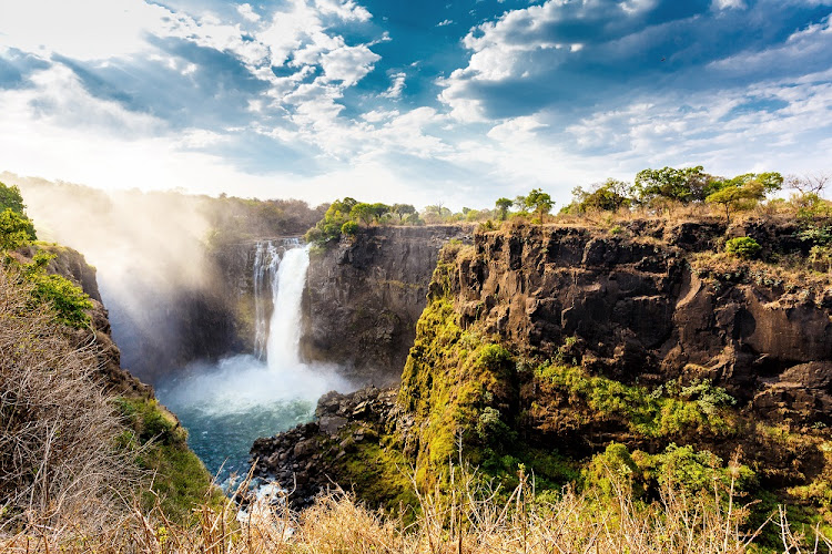 Victoria Falls, on the border between Zimbabwe and Zambia, is the largest curtain of water in the world (1708 meters wide). Picture: 123RF/ARTUSH