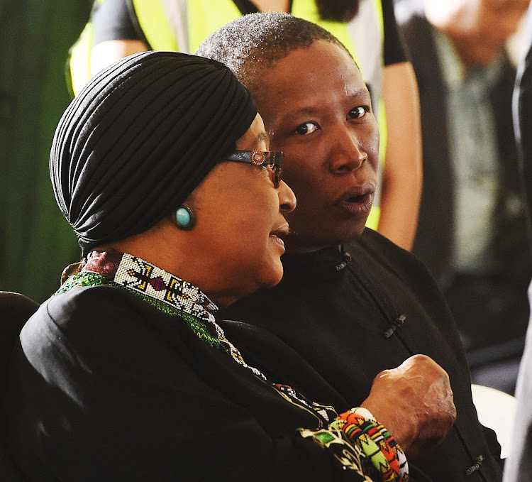 Anti-apartheid activist Winnie Madikizela-Mandela and EFF leader Julius Malema during the funeral service of ANC stalwart Ahmed Kathrada at Westpark Cemetery in Johannesburg on March 29, 2017. Picture: SIYABULELA DUDA