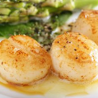 Simple Sea Scallops in Butter and Herb Sauce.