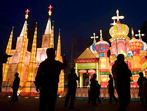 Photo: Chinese visitors look at elaborate lanterns, meant to look like Notre Dame, left, and St. Basil's Cathedral, at a Lantern Festival display in Fangshan, south of Beijing, Wednesday, Feb. 20, 2008.  The Lantern Festival or Yuanxiao Jie is a traditional Chinese festival, which falls on the 15th of the first month of the Chinese New Year. It is the last day of the two week long Chinese New Year cerebration, which people celebrate by visiting parks with elaborate lantern displays after darkness falls.  (AP Photo/Natalie Behring)