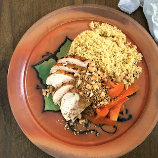 Bone Broth Couscous with Rotisserie Chicken, Melted Carrots, and Dukkah Spice.