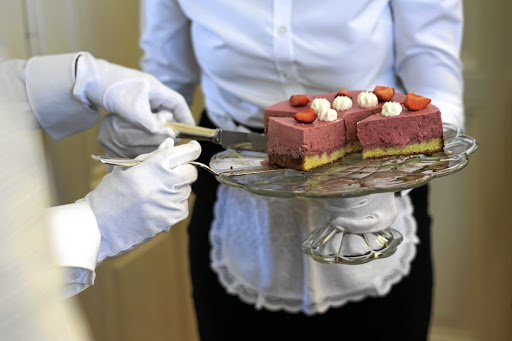 Women learn how to serve a dessert during a lesson at  Switzerland's last finishing school,  Institut Villa Pierrefeu. Picture: AFP