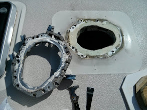 Photo: I am unsure what sealant was used to bed the mast collar. Fortuntely it peeled away from the deck easily.