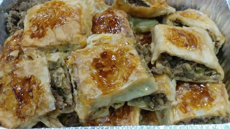 Rolled Pies with Ground Beef, Onion, Herbs and mild spices.