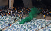 Fans set the Moses Mabhida Stadium seats on fire in Durban and vandalise property and broadcast equipment after Kaizer Chiefs lost a Nedbank Cup semi final match against unfancied Free State Stars on April 21 2018.