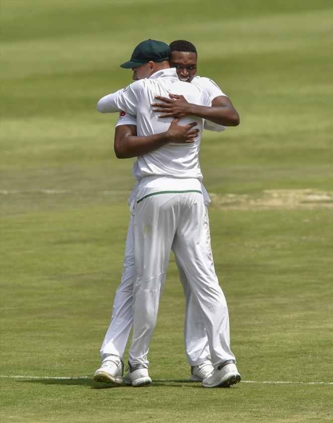 Aiden Markram and Lungi Ngidi of South Africa celebrate after Ngidi got the wicket of Virat Kohli(c) of India(unseen) during day 1 of the 3rd Sunfoil Test match between South Africa and India at Bidvest Wanderers Stadium on January 24, 2018 in Johannesburg.
