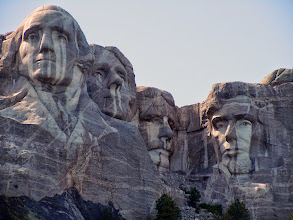 Photo: The rain does funny things to the big faces. Jefferson, have a tissue!