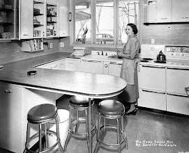 Photo: 1952 This lady must be showing off her brand new kitchen.